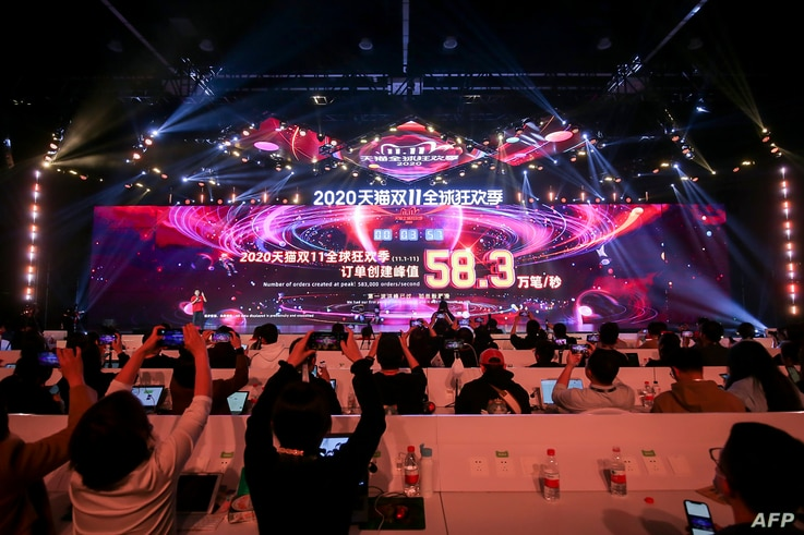 A screen shows sales information during the 2020 Tmall Global Shopping Festival on Singles' Day, also known as the Double 11…