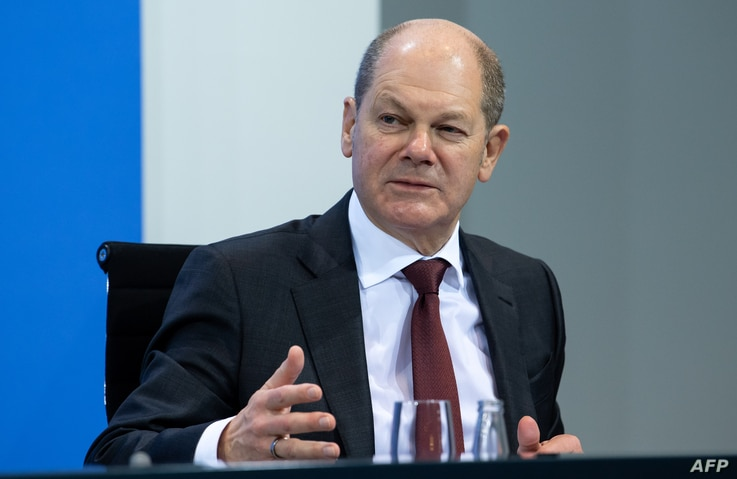 German Finance Minister and Vice-Chancellor Olaf Scholz addresses a press conference following talks via video conference with...