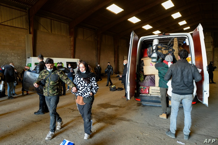 French Gendarmes evacuate the last partygoers who attended a rave in a disused hangar in Lieuron about 40km (around 24 miles)…
