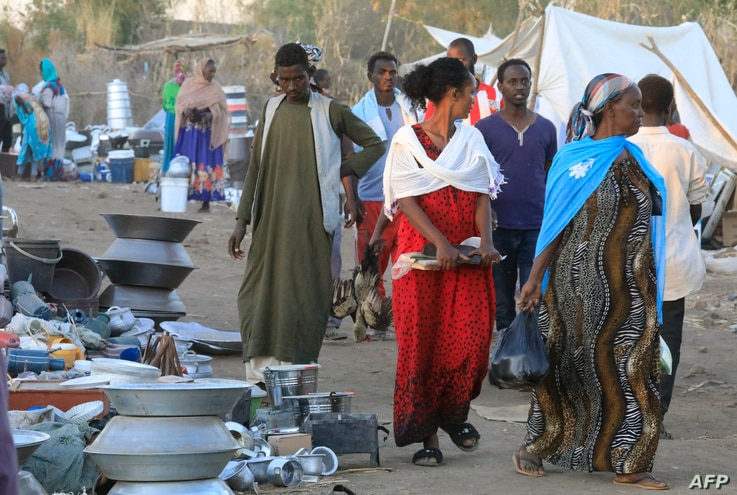 Ethiopians who fled the Tigray conflict buy supplies at a market near the Um Raquba refugee camp in Sudan's eastern Gedaref…