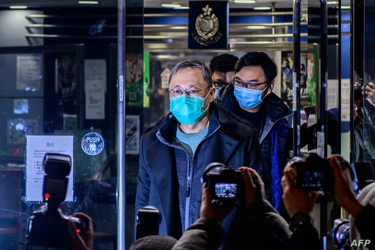 Hong Kong law professor and pro-democracy activist Benny Tai gestures outside Ma On Shan Police station following his release…