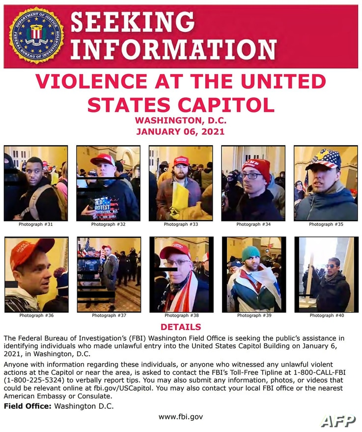 This image released by the FBI on January 8, 2021, shows protesters in the US Capitol on January 6, in Washington, DC. The FBI…