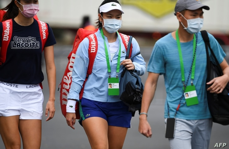 Tennis player Latisha Chan of Taiwan (C) leaves the hotel for a training session in Melbourne on January 19, 2021, while…