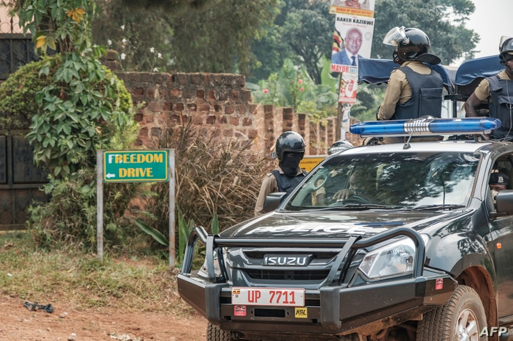 A patrol car of the Ugandan police is seen stationed outside the compound of Ugandan opposition leader Bobi WIne on January 20,…