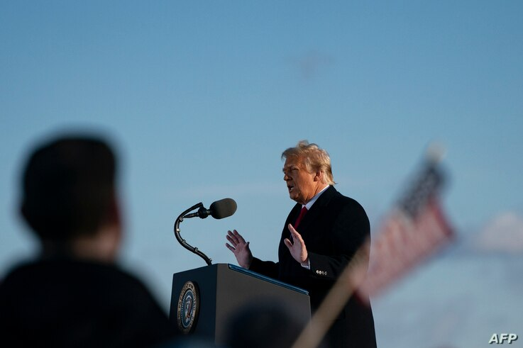 Outgoing US President Donald Trump addresses guests at Joint Base Andrews in Maryland on January 20, 2021. - President Trump...