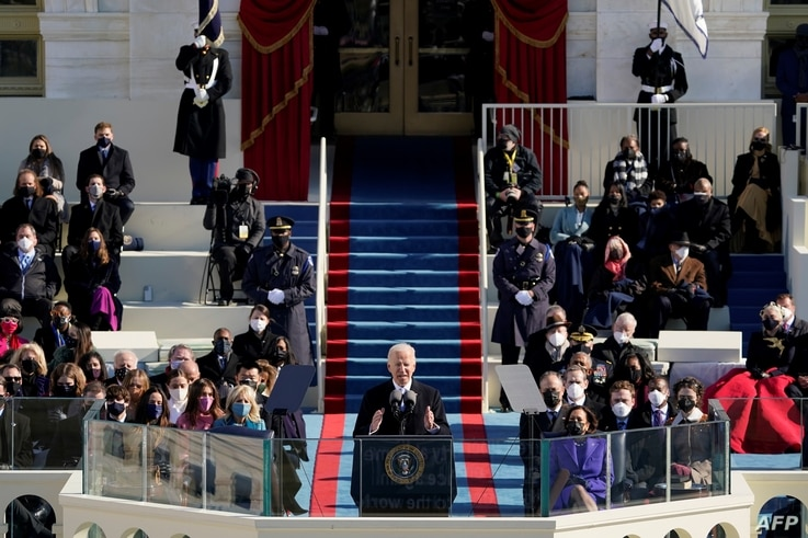 US President Joe Biden (C) delivers his inauguration speech after being sworn in as the 46th US President on January 20, 2021,…