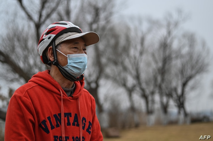 In this picture taken on January 21, 2021, Huang Genben, who spent 67 days in hospital fighting the Covid-19 coronavirus in…