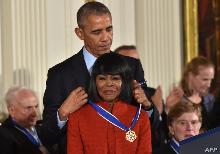 (FILES) In this file photo US President Barack Obama presents actress Cicely Tyson with the Presidential Medal of Freedom, the…