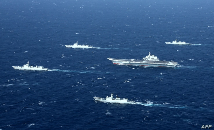 This photo taken on January 2, 2017 shows a Chinese navy formation, including the aircraft carrier Liaoning (C) during military...