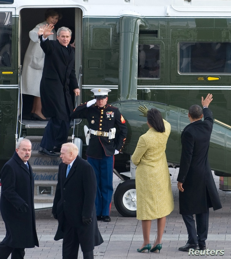U.S. President Barack Obama (R) waves alongside first lady Michelle Obama as former President George W. Bush and Laura Bush wave as they prepare to depart the U.S. Capitol on Inauguration Day in Washington, Jan. 20, 2009.