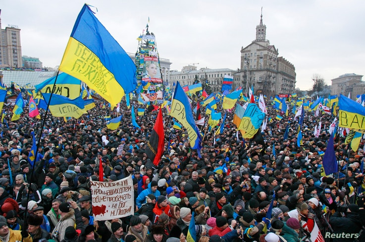 People attend a rally organized by supporters of EU integration at Maidan Nezalezhnosti or Independence Square in central Kiev,…