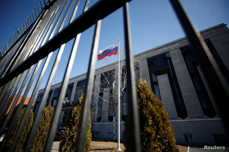 A flag is pictured outside the Russian embassy in Ottawa, Ontario, Canada, March 26, 2018. REUTERS/Chris Wattie