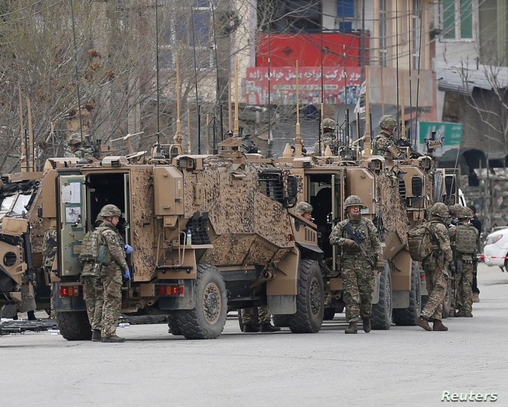 NATO soldiers inspect near the site of an attack in Kabul, Afghanistan March 25, 2020.REUTERS/Mohammad Ismail