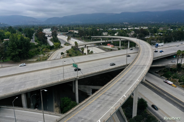 An empty freeway intersection is seen two days before Earth Day, after Los Angeles' stay-at-home order caused a drop in…