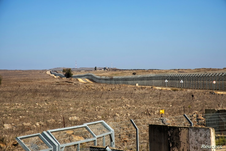 A general view picture shows a security fence near the border area between Israel and Syria, in the Israeli-occupied Golan...