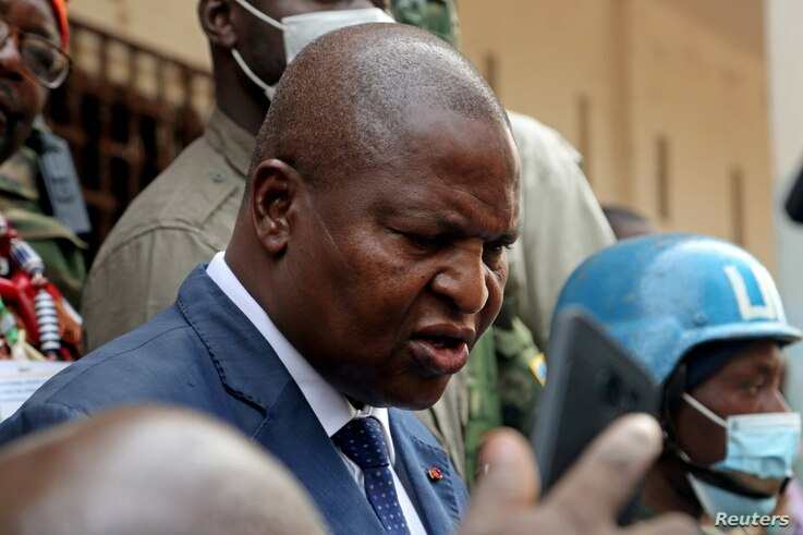 Central African Republic President Faustin Archange Touadera addresses the media outside a polling station, after casting his…