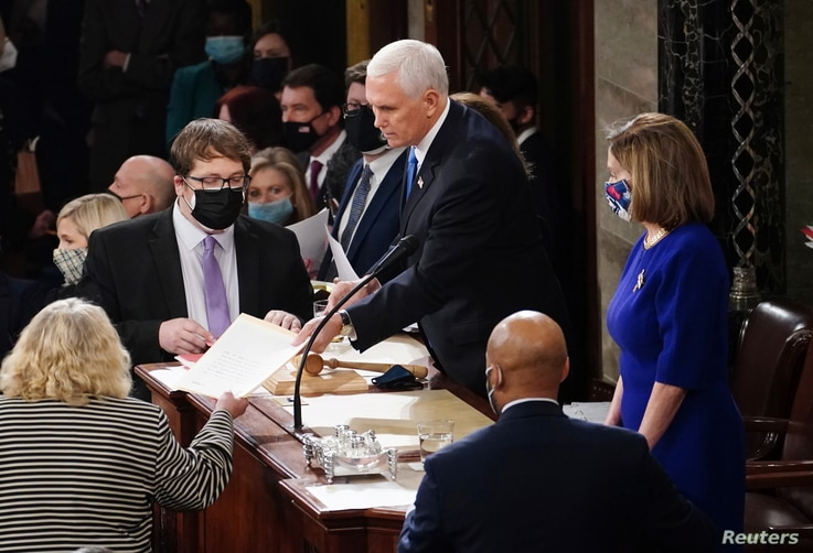 U.S. Vice President Mike Pence and Speaker of the House Nancy Pelosi (D-CA) take part in a joint session of Congress to certify…