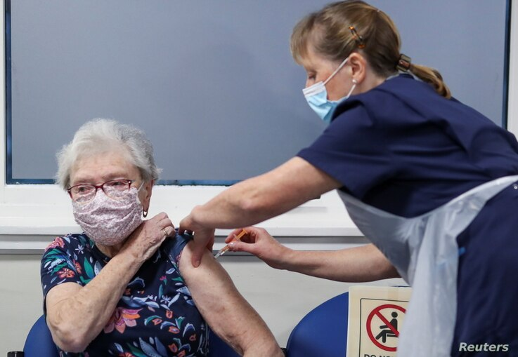 Lucy Airs receives a dose of AstraZeneca coronavirus disease (COVID-19) vaccine from Ruth Davies, a practice nurse, at the…