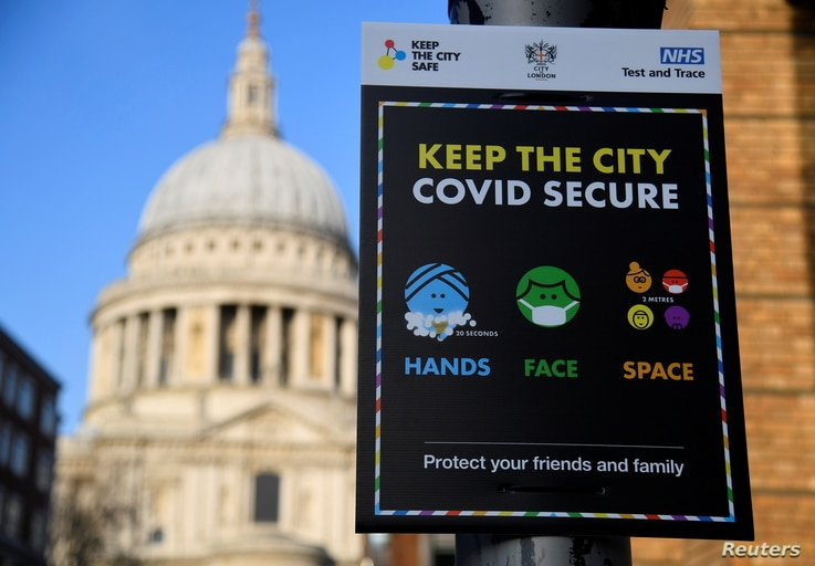 A public health information sign is seen with St. Paul's Cathedral seen behind amidst a lockdown during the spread of the...