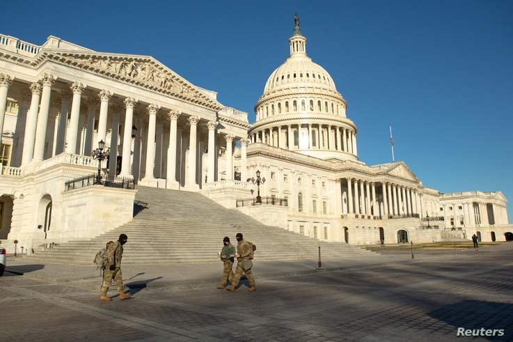 National Guard troops cross the grounds of the U.S. Capitol building on Capitol Hill in Washington, U.S., January 10, 2021…