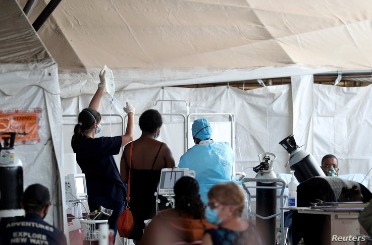 Health workers attend to patients in tents  at the parking lot of the Steve Biko Academic Hospital, amid a nationwide…