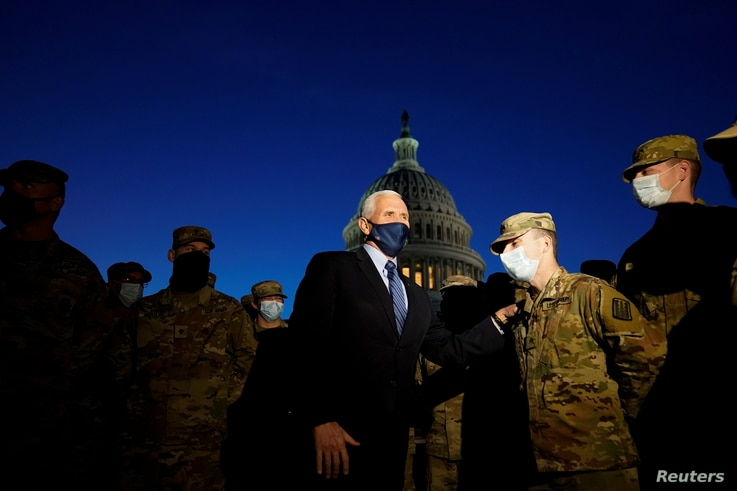Vice President Mike Pence speaks to National Guard troops outside the U.S. Capitol, January 14, 2021, in Washington. Alex...