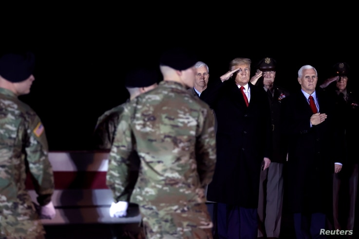 FILE - U.S. President Donald Trump and Vice President Mike Pence attend a dignified transfer