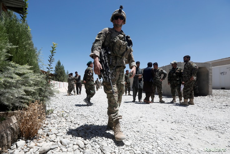 FILE - A U.S. soldier keeps watch at an Afghan National Army (ANA) base in Logar province, Afghanistan.