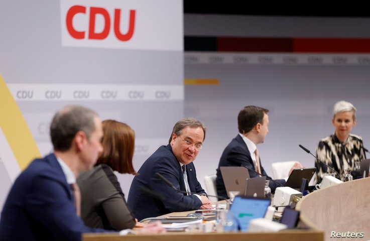 The new elected Christian Democratic Union (CDU) party leader Armin Laschet  sits on stage with delegates following his…