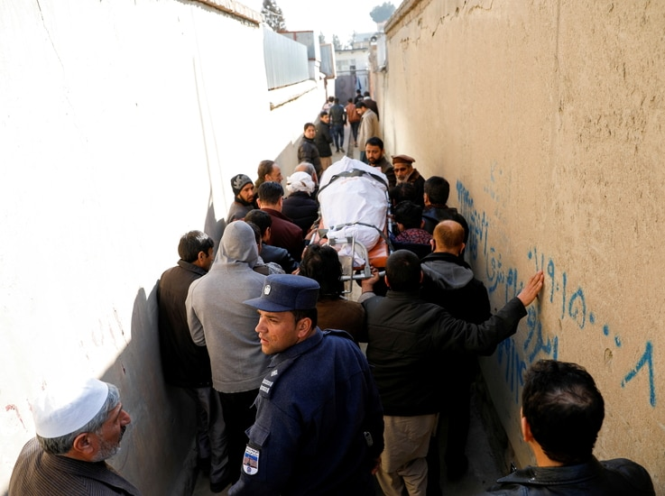 Relatives carry the body of one of the female judges shot dead by unknown gunmen in Kabul, Afghanistan January 17, 2021…