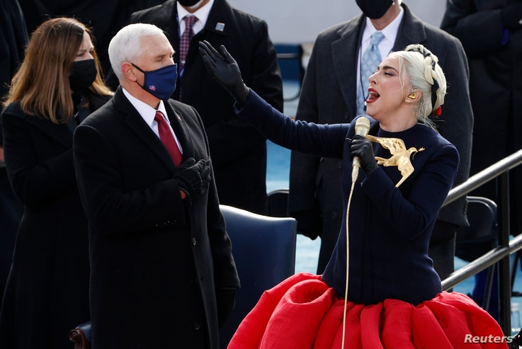 Lady Gaga sings the National Anthem as U.S. Vice President Mike Pence looks on during the National Anthem.