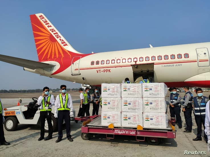 A plane is seen as Myanmar receives the first batch of the coronavirus disease (COVID-19) vaccines from India at Yangon Airport…