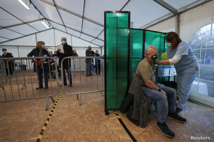 A person receives the Oxford/AstraZeneca coronavirus disease (COVID-19) vaccine at an NHS vaccination centre in York, Britain,…