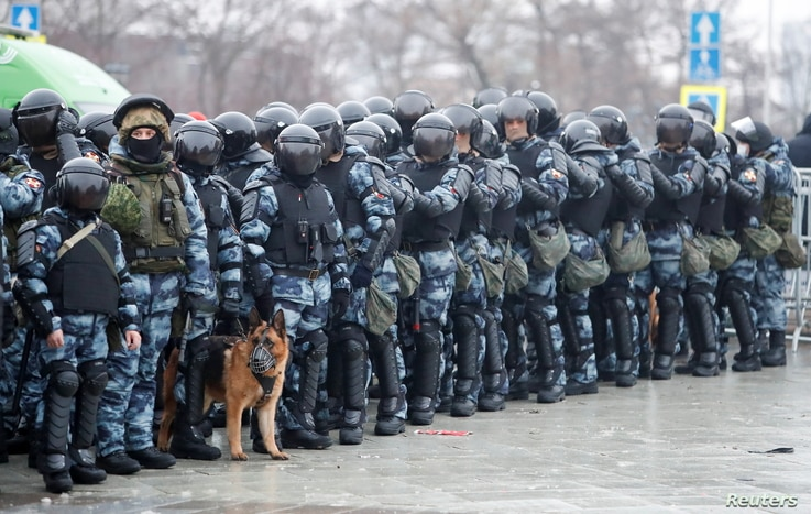 Law enforcement officers stand guard during a rally in support of jailed Russian opposition leader Alexei Navalny in Moscow, Russia, Jan. 23, 2021.