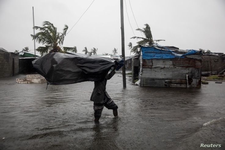Residents of the Praia Nova neighbourhood seek shelter and protection from Tropical Cyclone Eloise, in Beira, Mozambique,…