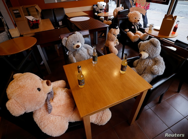 Teddy bears sit at tables in the Bap cafe after it was restricted to take-away sales only amid the outbreak of the coronavirus…