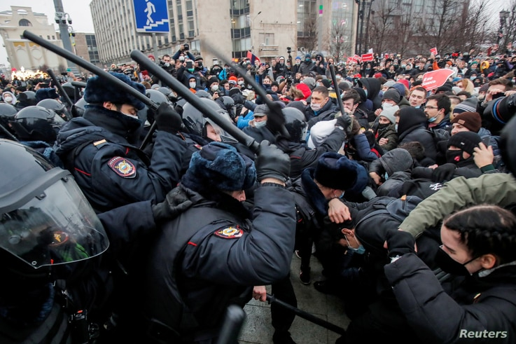 FILE PHOTO: Law enforcement officers clash with participants during a rally in support of jailed Russian opposition politician…