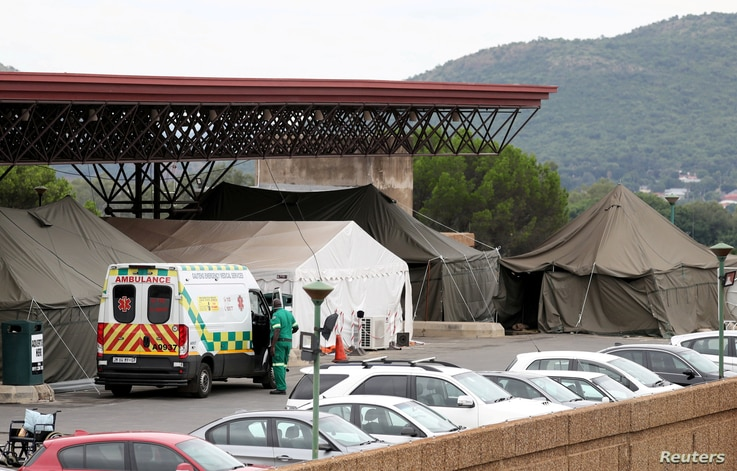 FILE - An ambulance is parked near tents erected at the parking lot of the Steve Biko Academic Hospital, amid a nationwide coronavirus disease (COVID-19) lockdown, in Pretoria, South Africa, Jan. 11, 2021.