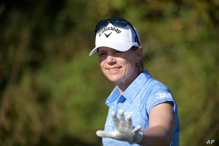 FILE - In this Dec. 7, 2019, file photo, Annika Sorenstam, of Sweden, waves to spectators after teeing off on the first hole...