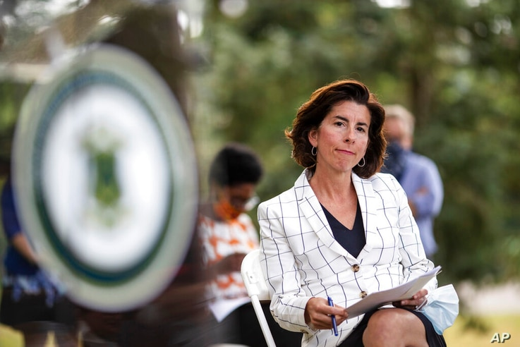 FILE - In this June 22 2020 file photo Rhode Island Gov. Gina Raimondo sits during a news conference in Providence, R.I.,  …