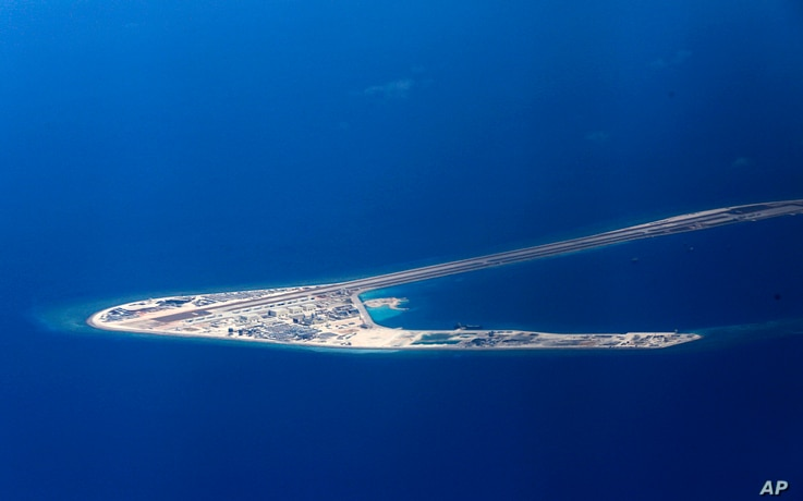 FILE - In this April 21, 2017, file photo, Chinese structures and an airstrip on the man-made Subi Reef at the Spratlys group…