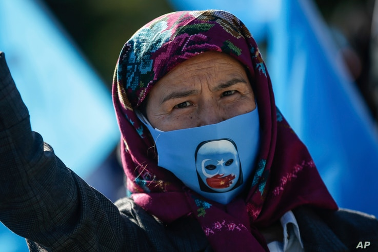A protester from the Uighur community living in Turkey, participates in a protest in Istanbul, Thursday, Oct. 1, 2020, against…