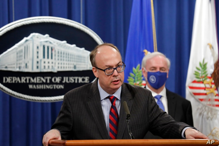 Acting Assistant U.S. Attorney General Jeffrey Clark speaks as he stands next to Deputy Attorney General Jeffrey A. Rosen...