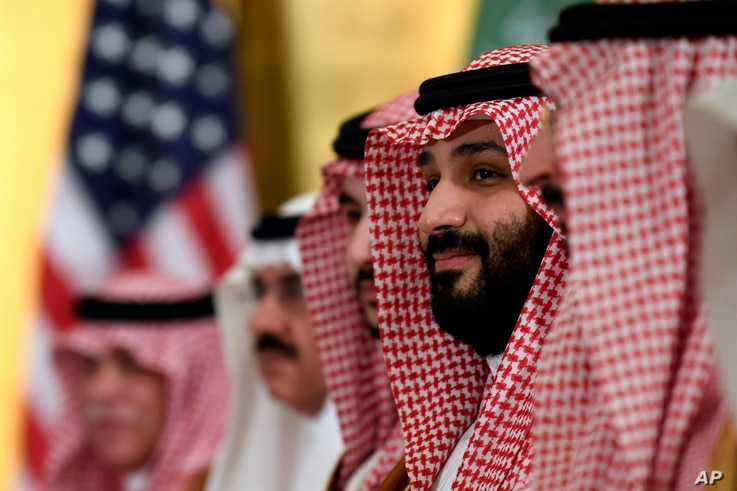 FILE - In this June 29, 2019 file photo, Saudi Arabia's Crown Prince Mohammed bin Salman listens during his meeting with...