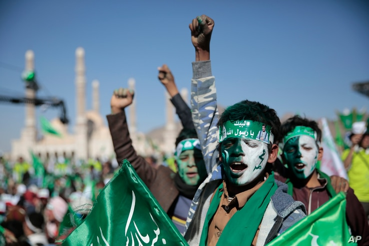 Supporters of Shiite rebels, known as Houthis, chant slogans as they attend a celebration of moulid al-nabi, the birth of Islam...