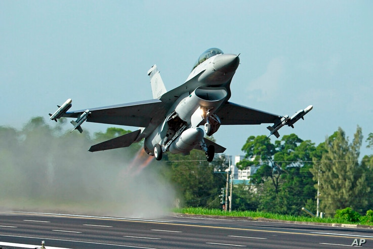 FILE - In this Sept. 16, 2014, file photo, Taiwan Air Force's F-16 fighter jet takes off from a closed section of highway…