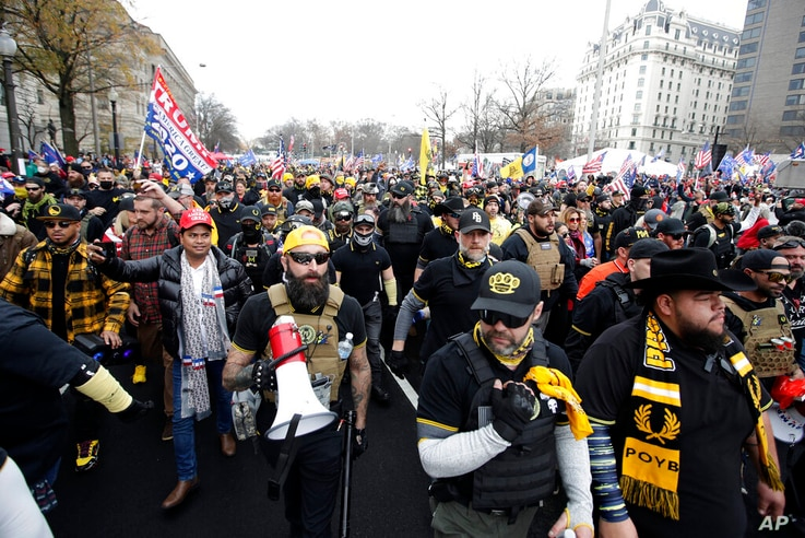 Supporters of President Donald Trump who are wearing attire associated with the Proud Boys attend a rally at Freedom Plaza,…