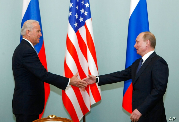 FILE - In this March 10, 2011, file photo, Vice President of the United States Joe Biden, left, shakes hands with Russian Prime...