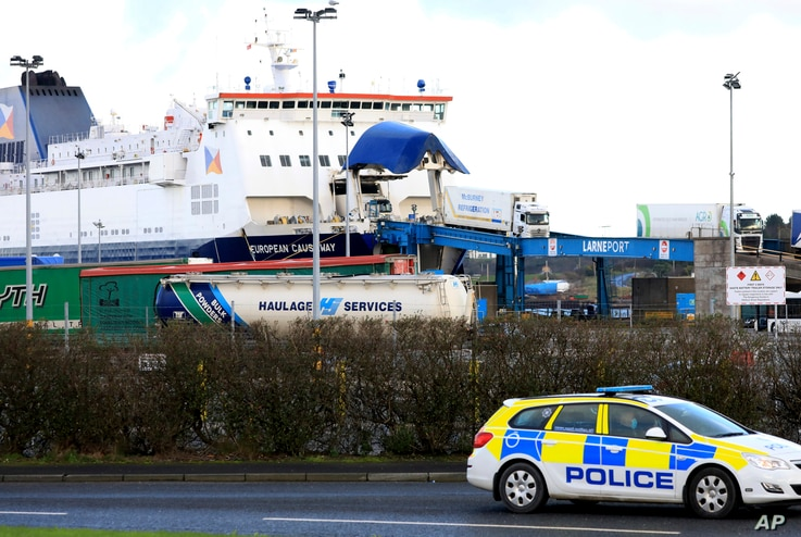 Lorries disembark a ferry from Scotland, at the P&O ferry terminal in the port at Larne on the north coast of Northern Ireland, Jan. 1, 2021.