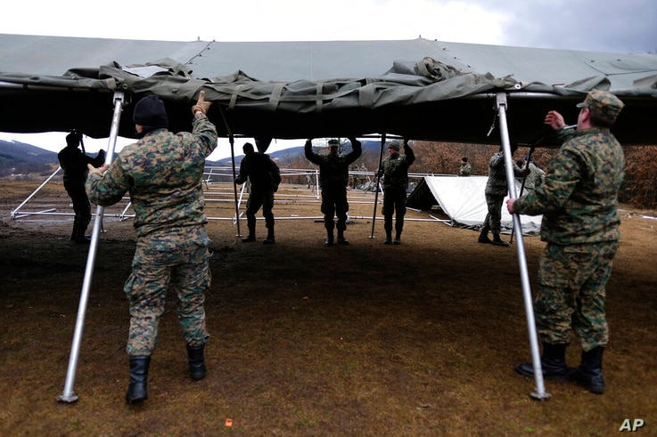 Bosnian soldiers put up the tents at the Lipa camp outside Bihac, Bosnia, Friday, Jan. 1, 2021. The Bosnian army on Friday were…